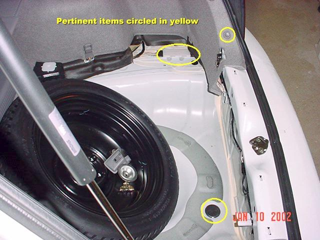 factory subaru trailer hitch installation the section to the right of the muffler did not need to be removed and only interferes slightly in one space the trailer hitch receiver once installed